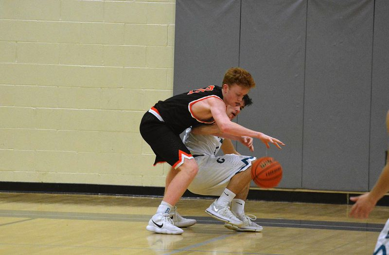 TIMES PHOTO: MATT SINGLEDECKER - Beaverton sophomore John Oleson chases after a loose ball against Century on Tuesday.