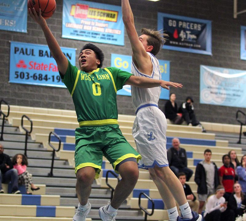 TIDINGS PHOTO: MILES VANCE - West Linn junior Drayton Caoile soars to the basket during his team's 76-48 win over Lakeridge at Lakeridge High School on Tuesday night.