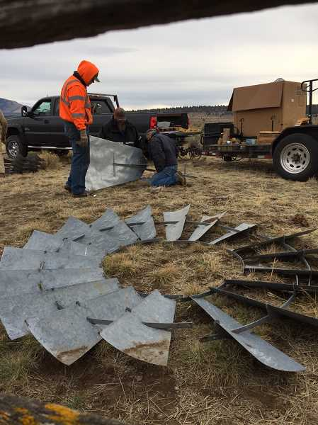 CROOKED RIVER NATIONAL GRASSLANDS PHOTO - In November, members of the Gray Butte Grazing Association restored two windmills on the Crooked River National Grassland, honoring the homesteading legacy of the area.