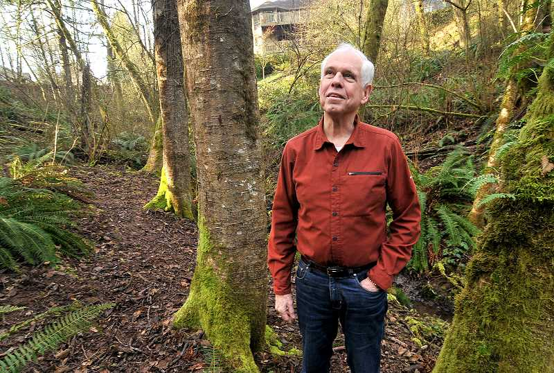 Bruce Johnson admires the natural beauty of the Skye Parkway Open Space. Johnson and two other neighbors have spent nearly 10 years working to rehabilitate the space.