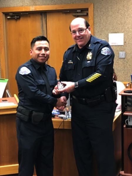 COURTESY PHOTO: CITY OF WOODBURN - Woodburn Police Chief Jim Ferraris welcomes new police officer Valentin Silva Cruz to the force Feb. 12.