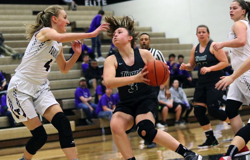 DAN BROOD - Tigard junior Campbell Gray looks to go to the basket during Tuesday's game at Tualatin.