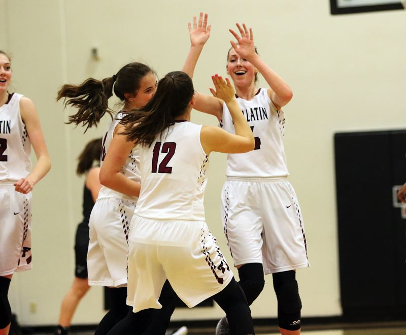 DAN BROOD - Tualatin junior Natali Denning (right) is congratulated by her teammates after sinking a buzzer-beating 3-pointer at the end of the first quarter.