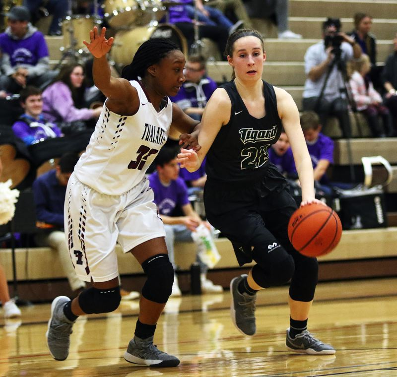 DAN BROOD - Tigard sophomore Delaney Leavitt (right) tries to drive against Tualatin junior Maliyah Ross during Tuesday's game.