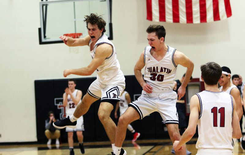 DAN BROOD - Tualatin High School seniors Lucas Noland (left) and Chris Freese celebrate following the Wolves' 53-51 win over rival Tigard on Tuesday.