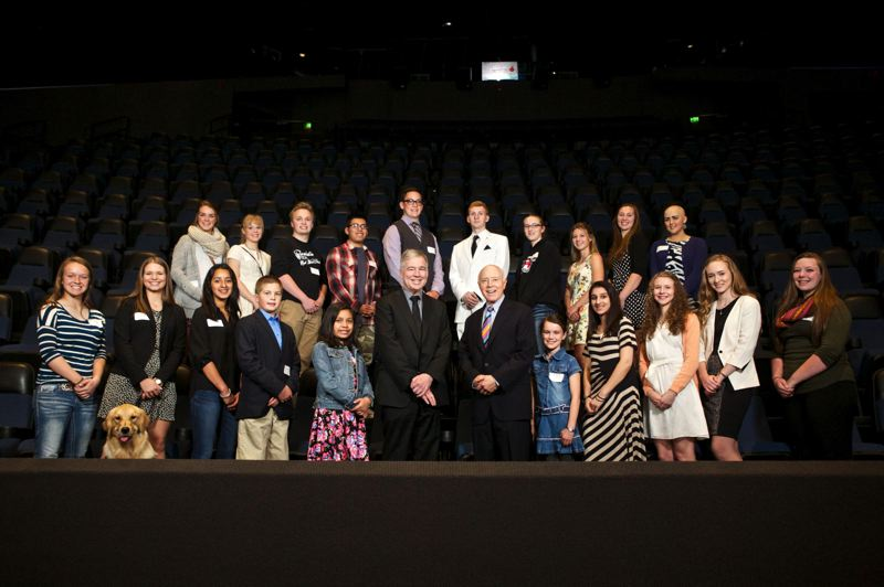 FILE - Amazing Kids featured in Pamplin Media Group's 2015 publication pose for a photo with publisher Mark Garber, left-center, and owner Dr. Robert B. Pamplin Jr., right-center.