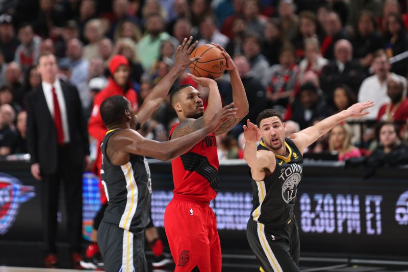 TRIBUNE PHOTO: DAVID BLAIR - Golden State tries to get to Damian Lillard, but the Blazers guard goes up for two of his 44 points.