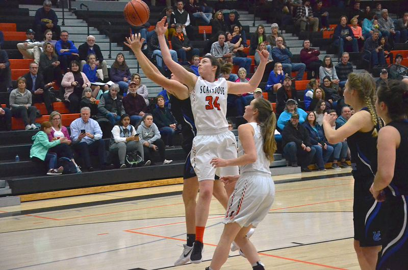 SPOTLIGHT PHOTO: JOHN BREWINGTON - Scappoose's Shaylan Smith battles for a rebound during her team's Tuesday home loss against Valley Catholic.