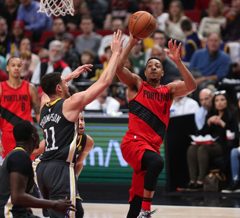 TRIBUNE PHOTO: DAVID BLAIR - CJ McCollum of the Blazers goes up for a shot against Klay Thompson of the Golden State Warriors.