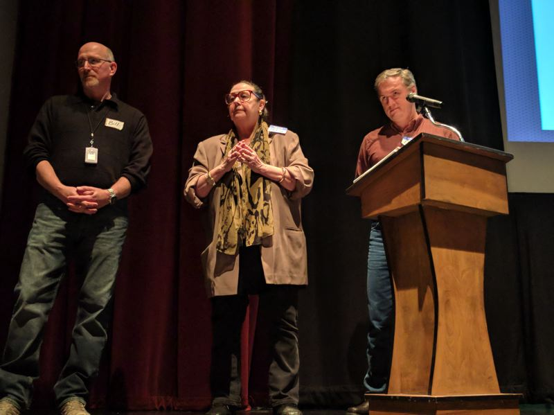 SPOTLIGHT PHOTO: COURTNEY VAUGHN - Bill Gerry of Boeing joins Sen. Betsy Johnson and Chris Holden of Portland Community College on stage during the Scappoose annual town meeting.