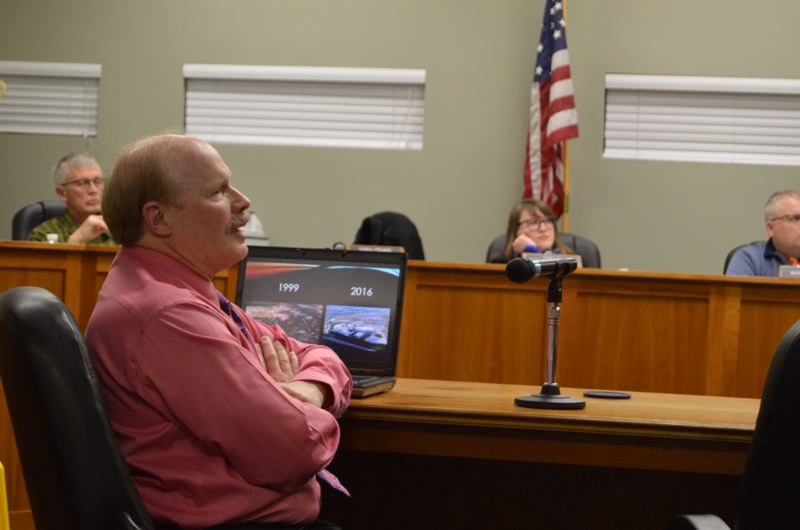 SPOTLIGHT PHOTO: COURTNEY VAUGHN - Scappoose City Councilor Mark Reed gives a presentation to councilors in December after returning from a trip to Sheffield, England, to tour the Advanced Manufacturing Research Centre.