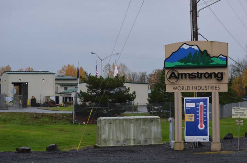 SPOTLIGHT FILE PHOTO - Armstrong World Industries, a ceiling tile manufacturer in St. Helens, and Owens Corning, a former fiberglass composites company, are in discussions with the Oregon Department of Environmental Quality to settle liability for property cleanup. Last November, Armstrong announced closure of its facility by mid-2018.