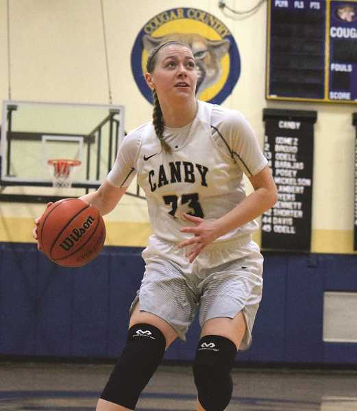 HERALD PHOTO: TANNER RUSS - Senior Cassidy Posey played more of a supporting role against the Lake Oswego girls basketball team on Tuesday, Feb. 13. The senior only had five points, but had several assists.