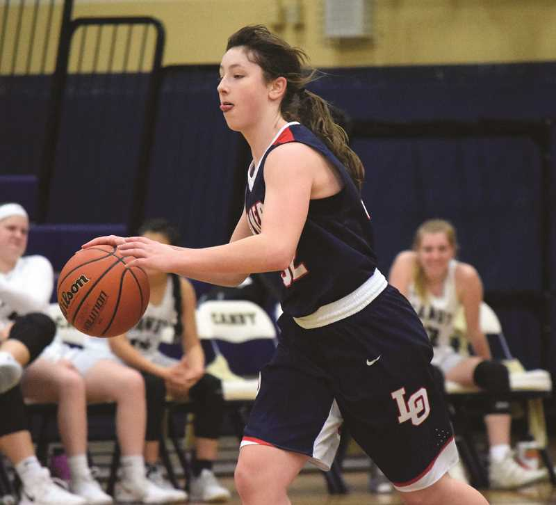 HERALD PHOTO: TANNER RUSS - Lake Oswego freshman Janie Ruttert had six points in the Feb. 13 game against Canby. Ruttert scored the most emphatic basket against the Cougars, a pull up jumper from the top of the key to start off the second half.