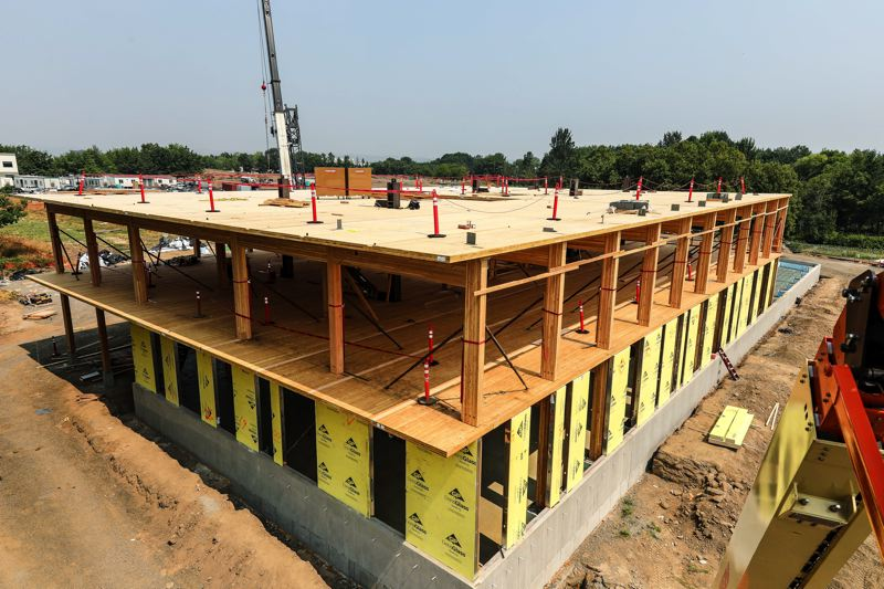 SUBMITTED: SWINERTON BUILDERS - Advances in technology allow mass timber to be used efficiently again on a grand scale, and Swinerton is one of the few general contractors to self-install the CLT instead of hiring a subcontractor.