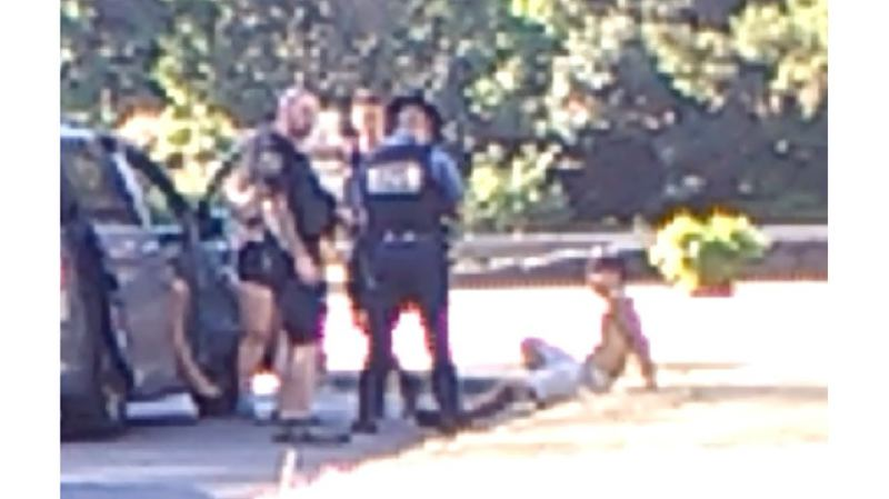OUTLOOK FILE PHOTO - A 15-year-old Vancouver boy, pictured in a blurred photo at the time of his arrest last summer, has pleaded guilty and apologized for starting the Eagle Creek Fire.