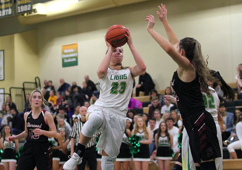 TIDINGS PHOTO: MILES VANCE - West Linn freshman Makayla Long goes up for a shot during her team's 57-37 home win over Sherwood on Friday night.