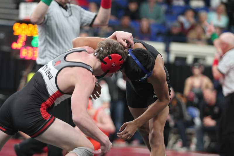 PHIL HAWKINS - Woodburn sophomore Freddy Hernandez held his own against No. 1 Beau Ohlson in the first round of the 5A 126-pound bracket, but ultimately fell by pinfall and went 0-2 on the day.