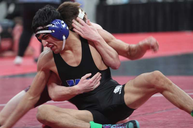 PHIL HAWKINS - Woodburn junior Giovanni Bravo won his first round match against Trae Bolken in first round pinfall and advanced to the second day of competition in the 5A 138-pound bracket.