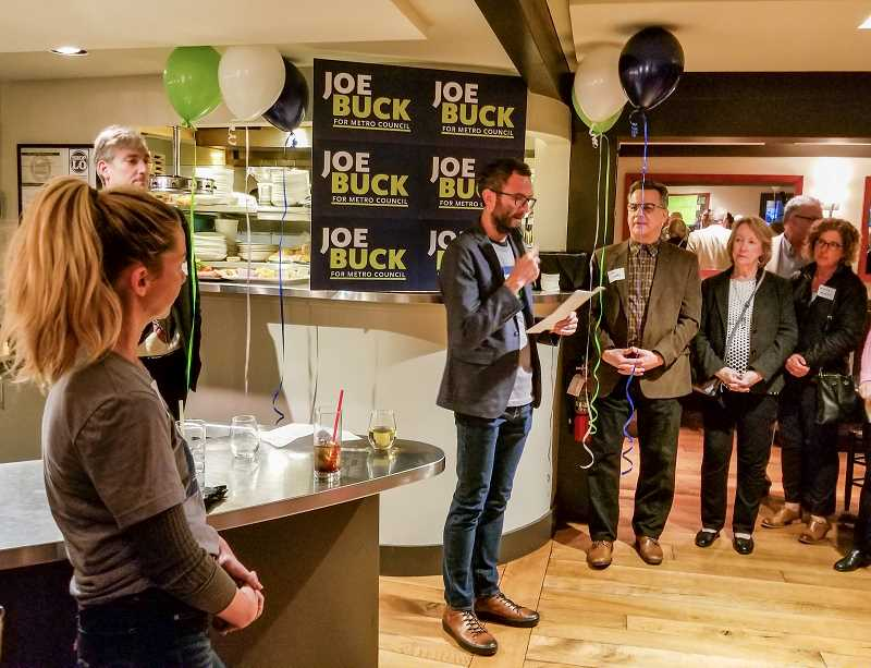 REVIEW PHOTO: ANTHONY MACUK - Lake Oswego City Councilor Joe Buck addresses a crowd of supporters at his campaign kickoff event this week at Babica Hen Cafe.