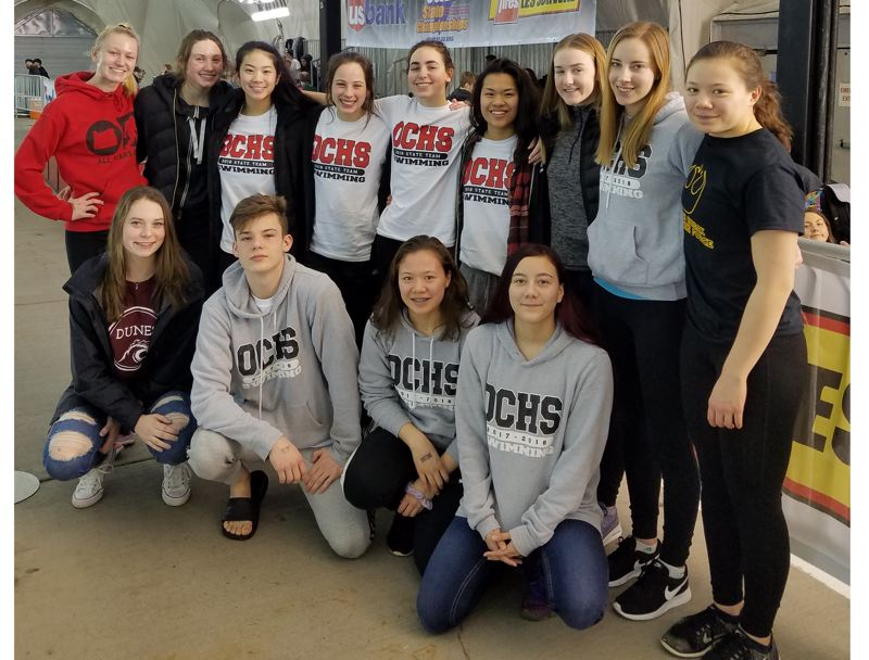 PHOTO COURTESY OF BRYAN WATT - Oregon City swimmers (back row, left to right) Jane Shroufe, Grace Zarosinski, Jackalyn Jaems, Olivia Watt, Grace Gunderson, Anna Pullella, Sophia Norgar, Rachel Boon, Makenzie Chan-Orcutt, (front row, left to right) Katelyn Willis, Ian Watt, Sydney Chan-Orcutt, and Samantha Brich represented the Pioneers at the OSAA Class 6A swimming state championships at Mt. Hood Community College.