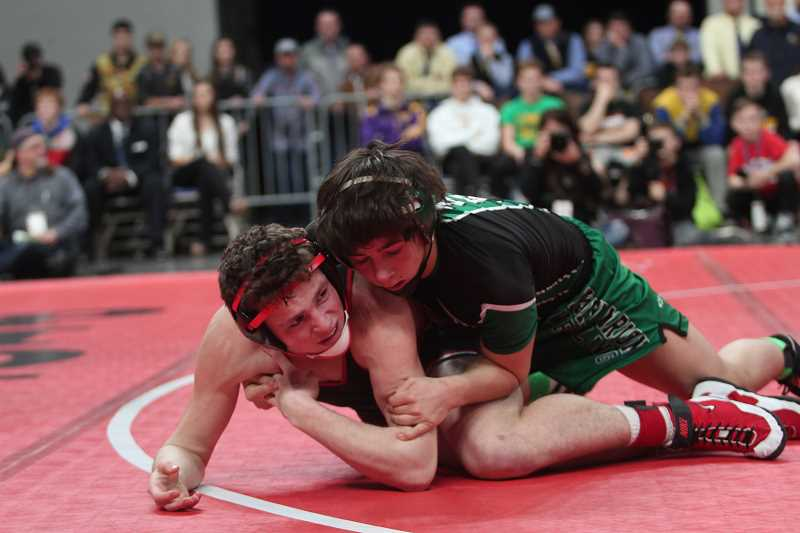 PHIL HAWKINS - Stigall's takedown of Tillamook sophomore Chad Werner in the closing seconds of the 4A 132-pound state championship match gave the North Marion junior a 5-2 lead, securing him the title as time expired.