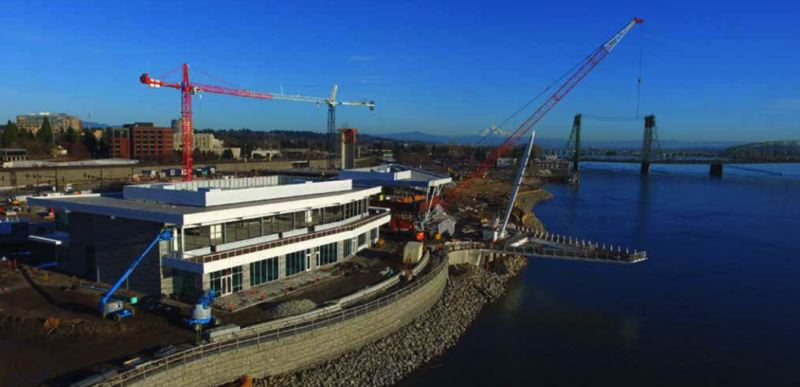 COURTESY: GRAMOR DEVELOPMENT, INC - Progess is visible now at the new Vancouver USA waterfront development by Gramor. The pier and the two restaurant buildings adjacent to it will open in August 2018. Twigs martini bar will lease the lower floor of the building just west of the pier (center of picture). In the distance is the old Red Lion on Port of Vancouver land, which will be demolished.