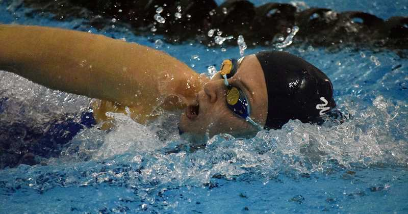 SPOKESMAN PHOTO: TANNER RUSS - Wilsonville senior Sarah Carr had a strong night at the state swim competition, which included narrowly taking second place in the 100-yard freestyle.