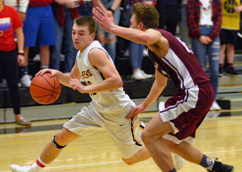 SPOTLIGHT PHOTO: MATT RAWLINGS - St. Helens senior Drake Dow drives to the basket during his team's 74-72 home loss to Sandy on Friday night at St. Helens High School.