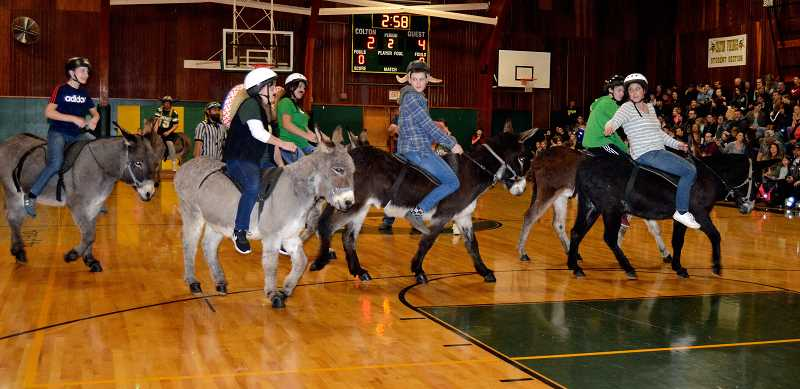 PIONEER PHOTO: CINDY FAMA - The CHS staff team takes on the eighth-grade team in last Saturday's Donkey Basketball game.