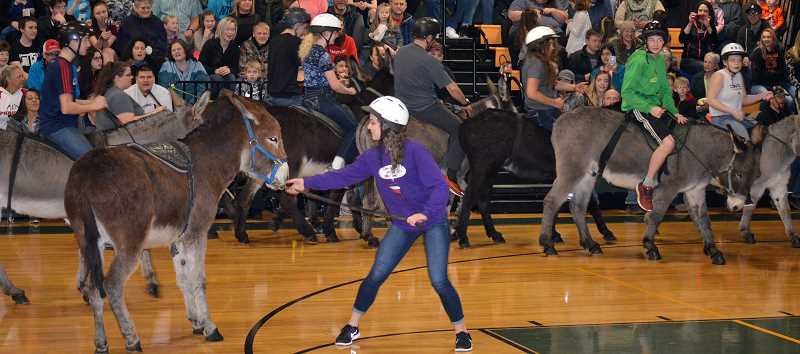 PIONEER PHOTO: CINDY FAMA - Senior team member Brooklyn Olsen tries to convince her donkey partner, 'let's go this way.'