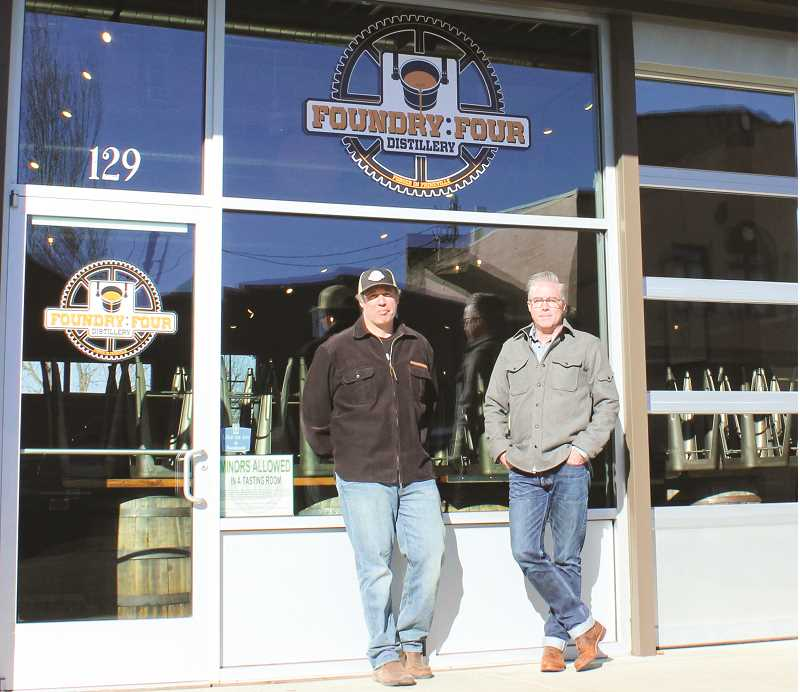 HOLLY SCHOLZ - Bryan Iverson, left, and Scott Ramsay have opened Foundry Four Distillery on Northwest Fourth Street in Prineville. Private parties may rent the venue, and the owners plan to open a tasting room and eventually produce their own Prineville brand of spirits.