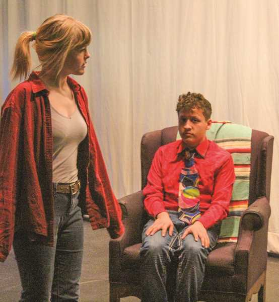 """HOLLY SCHOLZ - Crook County High School sophomore Alex Hughes, left, and freshman Uber Gonzalez, perform in """"I Think You Think I Love You,"""" a one-act comedy that they will perform later this week at CCHS."""