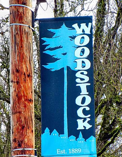 ELIZABETH USSHER GROFF - One of the Woodstock street banners, the design for which was donated by Laurie Levich.