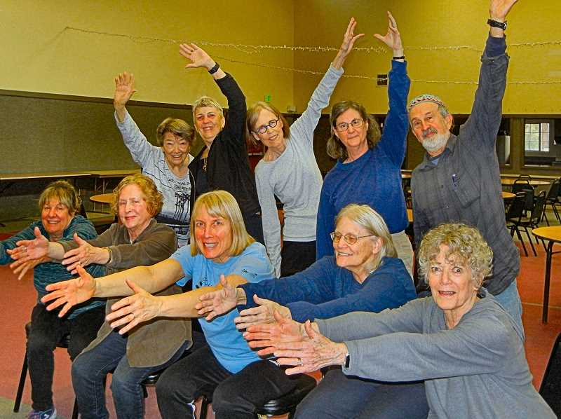 ELIZABETH USSHER GROFF - Shown here are ten of the regular twenty or so Sellwood attendees of the Better Bones and Balance class, posing for stretching photo. The class will reopen in Woodstock on March 20th.