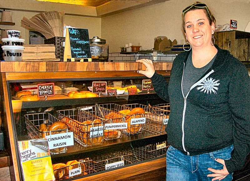 RITA A. LEONARD - Opening a new Sellwood location, Leah Orndoff displays some of the many boiled bagels made daily at Henry Higgins bakery.