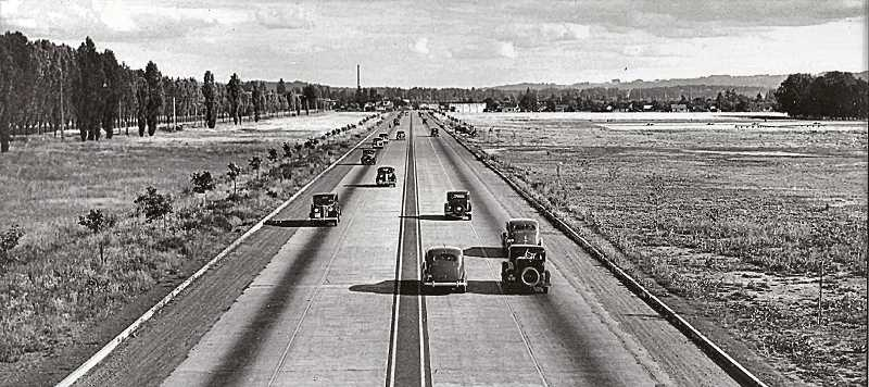 COURTESY OF SMILE HISTORY COMMITTEE - This photo shows the opening of the new four-lane Super Highway in 1937 - McLoughlin Boulevard. Small trees were planted on either side of the roadway to buffer the noise for homes nearby. Supporters of Rule 3 in this 1913 list would have approved of the tree planting, since it would eventually have provided a place for pedestrians to hide, to avoid scaring passing inexperienced drivers. Looking south apparently from the Bybee Bridge, we see the railroad tracks at left, and what become Westmoreland Park at right.