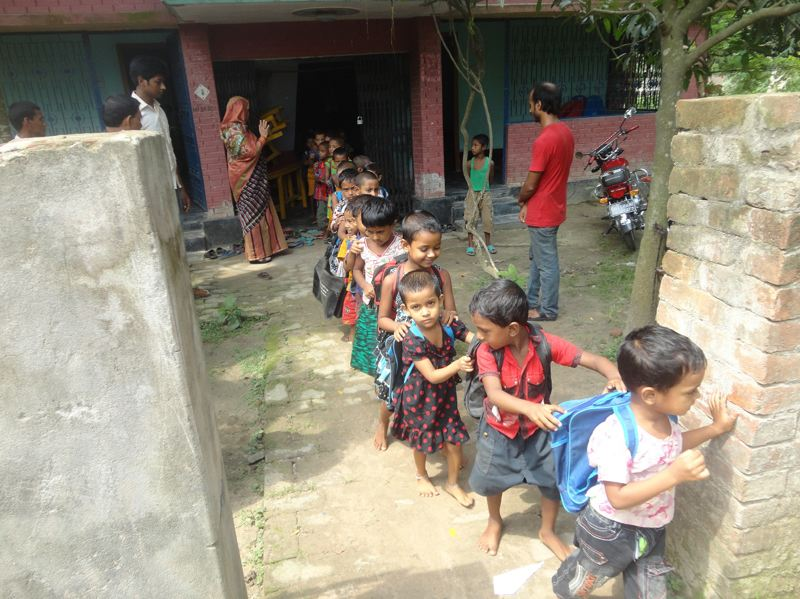 COURTESY PHOTO: ASHA-INC.  - Children file out of the All-Inclusive School in Rajshahi, Bangladesh. The school that includes students with disabilities was started two years ago with donations from Portland-based Asha-Inc.