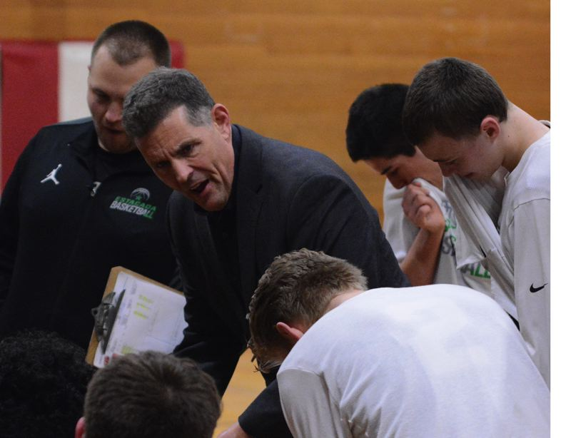 ESTACADA NEWS: DAVID BALL - Estacada High coach Kelly Norman goes over the game plan with his squad. The Rangers completed a season sweep of Molalla with last weeks 65-60 home win.