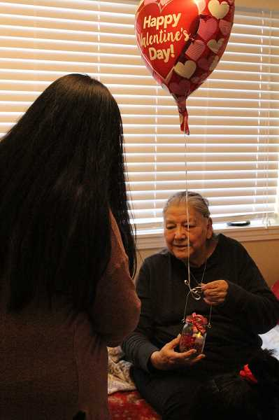 LINDSAY KEEFER - Felipa Villareal, a resident at Silver Creek Senior Living, receives a balloon, homemade card and candle on Feb. 14 from Success High School students as part of their fundraiser Surprise a Senior, Help a Child.