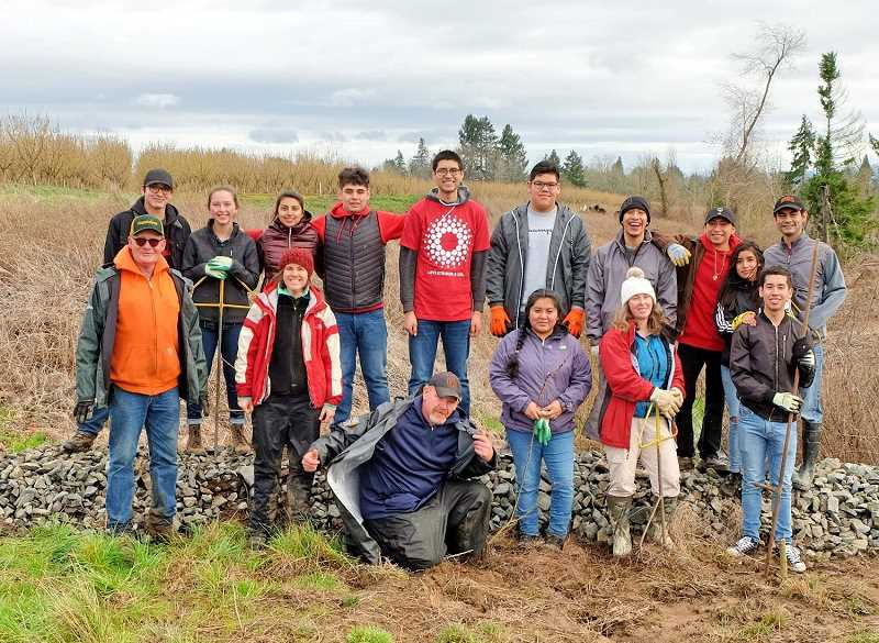 COURTESY PHOTO - Volunteers helped replant shrub and tree cuttings on private land along the Pudding River on Jan. 20 to help make the habitat better for fish and other aquatic wildlife.