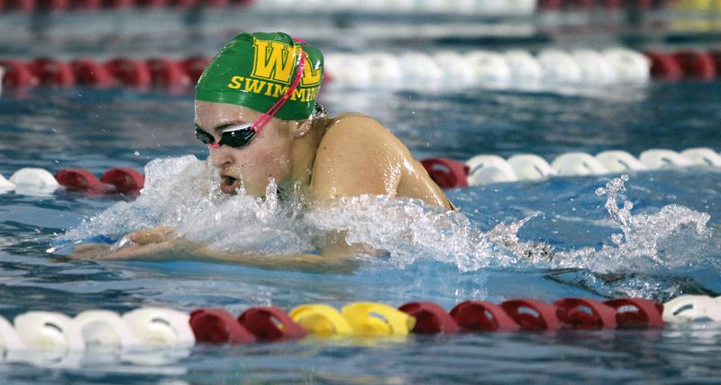 TIDINGS PHOTO: MILES VANCE - West Linn junior Katelyn Laderoute makes waves en route to her victory in the 200-yard individual medley at the Class 6A state swimming championship at Mt. Hood Community College Aquatic Center on Saturday.