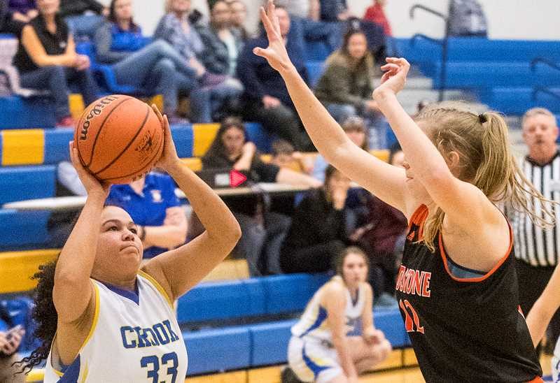 LON AUSTIN/CENTRAL OREGONIAN - Odessa Tramel-Green goes up for a shot against a Gladstone defender during a game earlier this year. Tramel-Green scored four points and grabbed 10 rebounds as the Cowgirls lost 55-23 to the Gladiators Friday night in Gladstone.