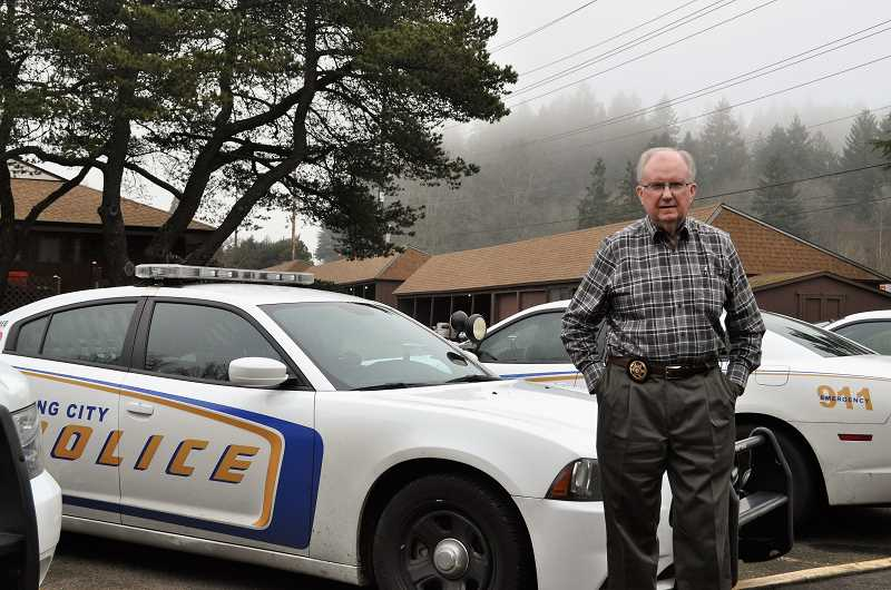 REGAL COURIER PHOTO: BLAIR STENVICK - Chuck Fessler stands outside the King City City Hall, where the police department is headquartered. The police chief will retire at the end of March.