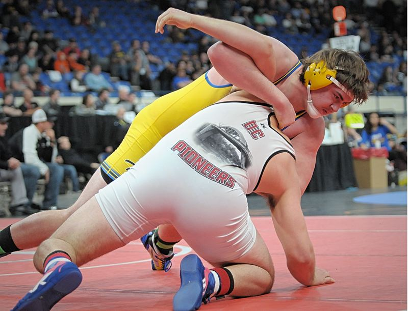 SETH GORDON - Newberg's Tristan Osborn turns Oregon City's Lane Marshall en route to a pin in 3:41 to win the 6A heavyweight state title Saturday night at the OSAA state championships in Portland. NHS claimed two individual titles and placed second as a team.