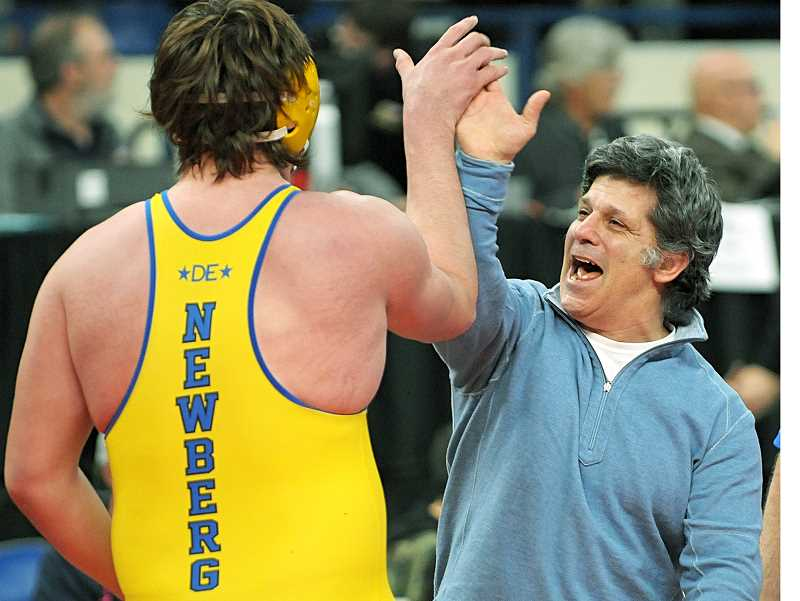 SETH GORDON - Senior Tristan Osborn gets a high five from coach Neil Russo after winning the 6A heavyweight state title Saturday night at the state championships.