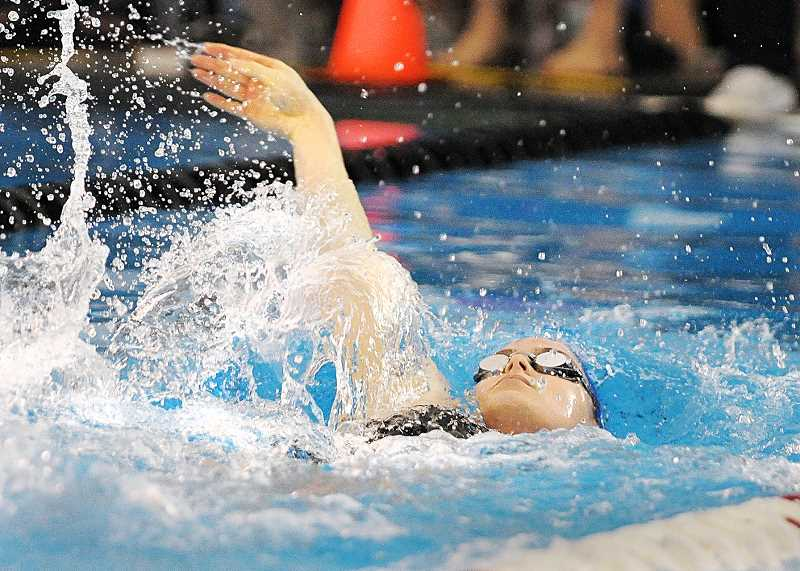 SETH GORDON - Stella Byles swims the backstroke leg of Newberg's 200 medley relay Saturday at the at the OSAA 6A state championships. The Tigers placed 11th in 1:55.91 and finished 13th as a team with 29 points.