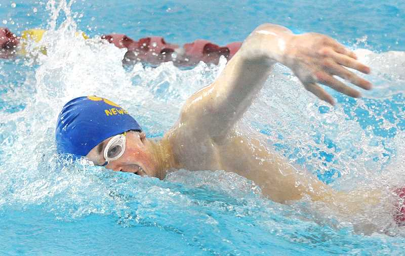 SETH GORDON - Zach Jordan cuts through the water at Mount Hood Community College during his leg of the 200 freestyle relay Saturday at the OSAA 6A state championships. Jordan and the Tigers placed fifth in a season-best 1:29.84 and placed 17th as a team with 28 points.