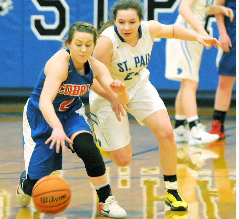SETH GORDON - Emma Connor pressures a Central Linn player during St. Paul's 46-43 district tournament semifinal win Feb. 14. The No. 6 Bucks will host No. 10 Bonanza in a first-round state playoff game at 6 p.m. Friday.