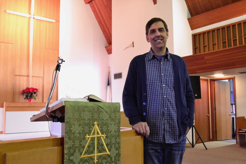 POST PHOTO: BRITTANY ALLEN - Pastor Kevin Fenster preaches to a congregation of 70 to 90 people at Immanuel Lutheran Church, 39901 Pleasant St, Sandy, every Sunday.